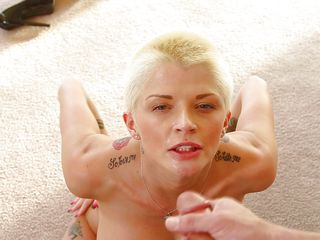 short haired and tattooed slut gives a head